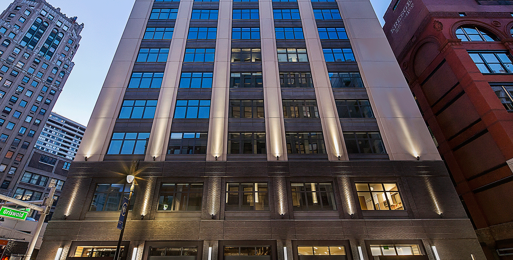 28 W Grand Lofts-Exterior-Facade-Dusk-1665x845
