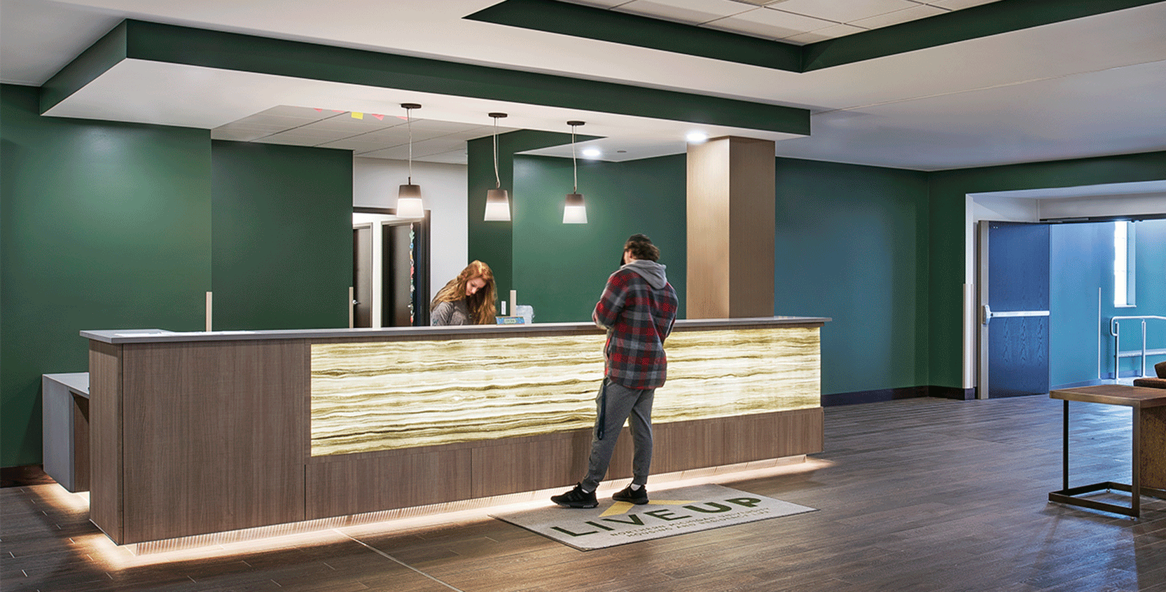 NMU-The-Woods-Front-Desk-1665x845
